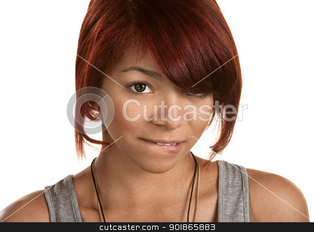 Teenager Biting Her Lip stock photo, Innocent female teen biting her lower lip by Scott Griessel