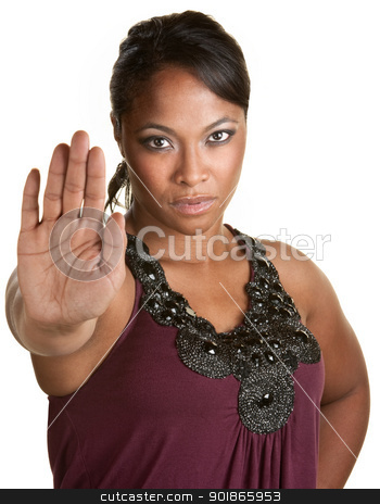 Lady Using Stop Gesture stock photo, Serious young woman holding hand in front by Scott Griessel