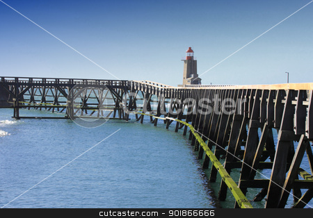 wooden pier and  lighthouse of the port of fcamps in normandy france stock photo, wooden pier and  lighthouse of the port of fcamps in normandy france by Chretien