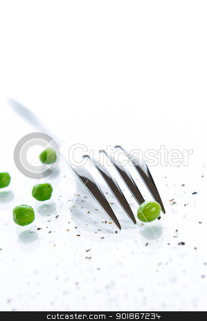 Close-up of fork and peas stock photo, Fork has put teeth into a pea. Salt and pepper sprinkled over by Instudio 68