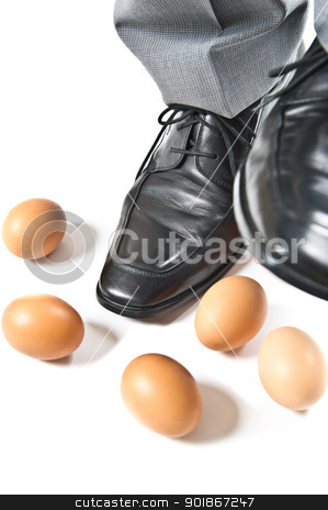 Feet over eggs stock photo, en's dress shoes stepping over several eggs. by Instudio 68