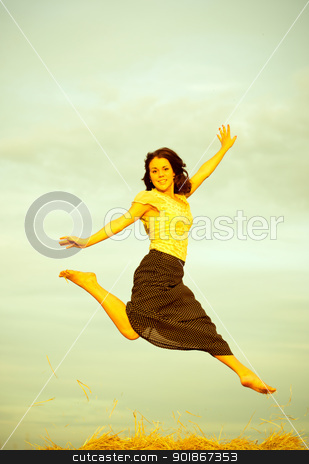 Countryside scene stock photo, Young women jumping on a field in rural areas. Old toned image by Imaster
