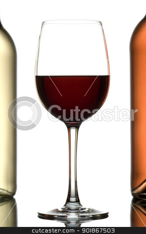 Wines. stock photo, Glass of wine between two bottles of wine isolated on white. by Piotr Skubisz