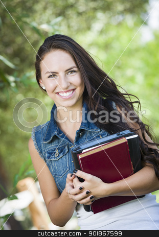 Mixed Race Young Girl Student with School Books  stock photo, Attractive Smiling Mixed Race Young Girl Student with School Books Outdoors. by Andy Dean