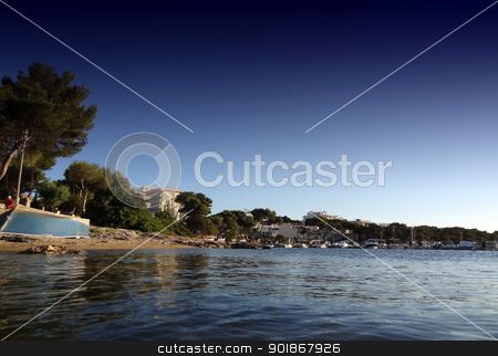 Beach shot with boat stock photo, Summer beach shot ideal desktop background with boat and hotels                                by Michael Travers