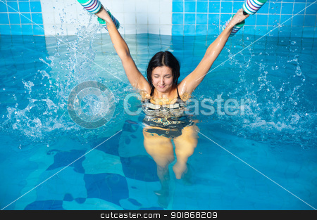 Attractive girl trains in aqua aerobics stock photo, Young beautiful woman doing aqua gym exercise with water dumbbell in a swimming pool by Aikon