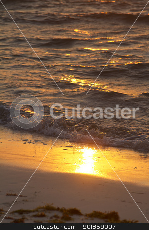 sunrise wave stock photo, Sunrise reflecting on wet sand being pounded by waves by Yann Poirier