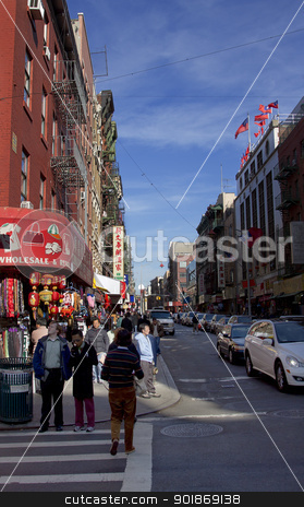 Chinatown shoppers stock photo, shoppers waiting at street corner in front of a souvenir store in New York Chinatown by Yann Poirier
