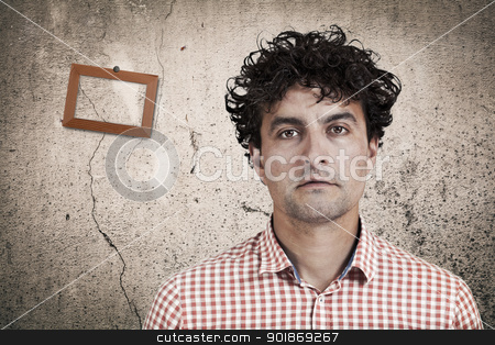 Placid stock photo, Man and old wall background with a frame  by tristanbm