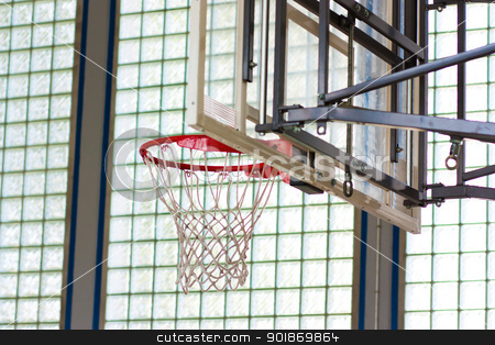 Basketball hoop in a gymnasium stock photo, Basketball hoop in a gymnasium by tristanbm