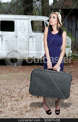 Vacation stock photo, Beautiful young woman going on vacation with a suitcase by Robert Byron