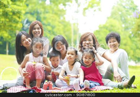 Picnic stock photo, Happy Asian family enjoying picnic at outdoor park by szefei
