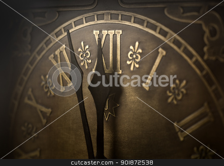 Almost twelve. stock photo, Old clock with roman numerals. Selective focus on  number XII and minute hand. Intentional vignetting. by Piotr Skubisz