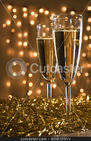 Two champagne flutes. stock photo, Two champagne flutes among golden ribbons, defocused lights on the background - focus on the first glass. by Piotr Skubisz