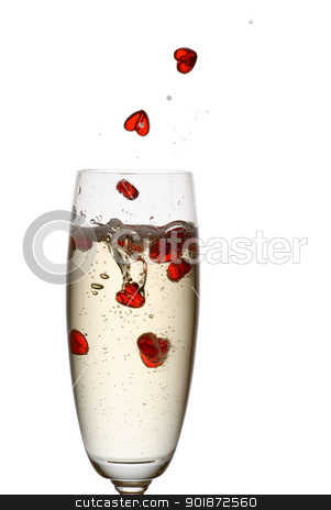 Champagne love. stock photo, Hearts falling down into champagne flute. by Piotr Skubisz