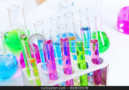 Chemistry laboratory glassware with colour liquids stock photo, Chemistry laboratory glassware with colour liquids in them by Sergey Nivens