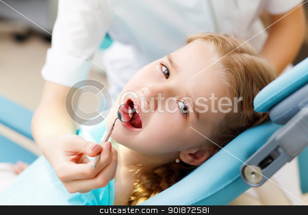 Little girl visiting dentist stock photo, Little girl sitting in the dentists office by Sergey Nivens