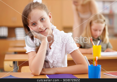 Little girl at school class stock photo, Little girl sitting and studying at school class by Sergey Nivens