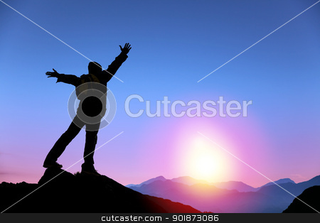 young man standing on the top of mountain and  watching the sunrise stock photo, young man standing on the top of mountain and  watching the sunrise by tomwang