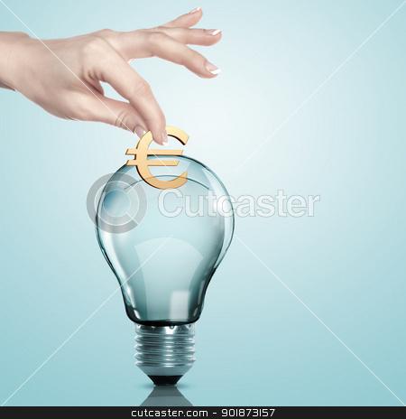 Money inside an electric light bulb stock photo, Hand and money inside an electric light bulb by Sergey Nivens