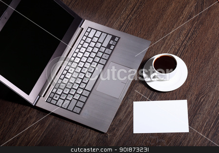 Coffee at business workplace stock photo, White cup with black coffee at business workplace by Sergey Nivens