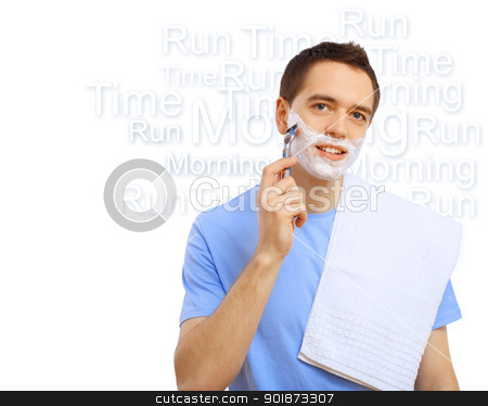 Young man shaving stock photo, Young man in blue T-shirt shaving himself by Sergey Nivens