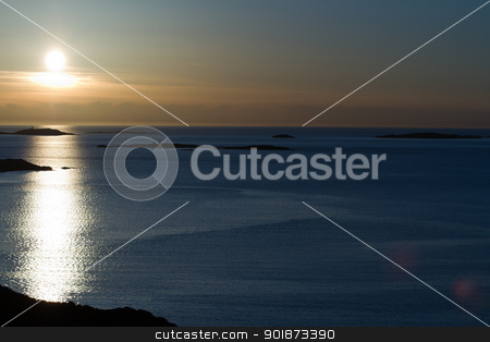 Blue Sunset stock photo, Winter Sunset over the rocks in Lysekil by Paul Murray Photography