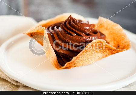 Mousse au chocolat stock photo, Mousse au chocolat in a tuile basket on dark old wooden table by p.studio66