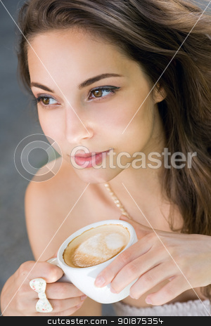 Young woman having coffee. stock photo, Closeup portrait of a beautiful young woman having coffee. by exvivo