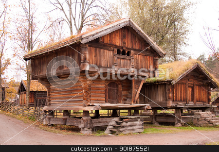 Norwegian typical wooden house stock photo, Norwegian typical wooden house with grass roof by Nanisimova