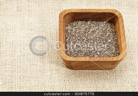 chia seeds in wood bowl stock photo, chia seeds in square wooden bowl against burlap canvas by Marek Uliasz