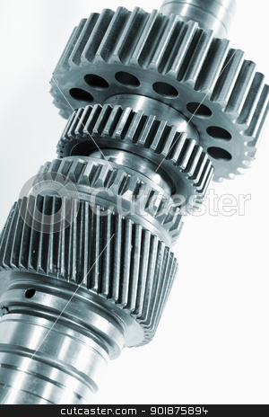 gear wheels and axles stock photo, gear wheels and axles, titaniu parts against light background by lagereek