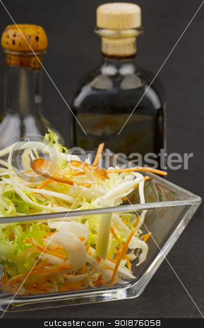 Salad stock photo, Close up of mixed salad with vinegar and oil on the background by Fabio Alcini
