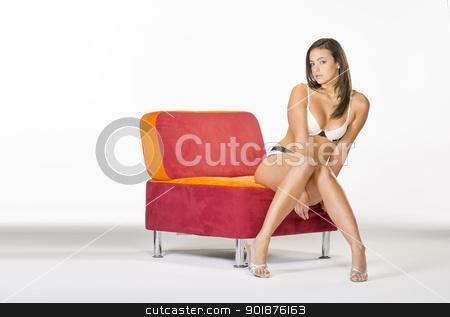 Brunette Model in Lingerie stock photo, Brunette model posing in lingerie in a studio environment by Walter Arce