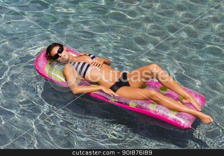 Pool Model stock photo, Beautiful bikini model lounges at the pool on a summer day by Walter Arce