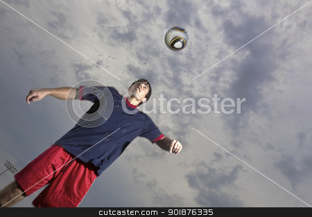 Soccer Player stock photo, Image of a soccer player in action by Walter Arce