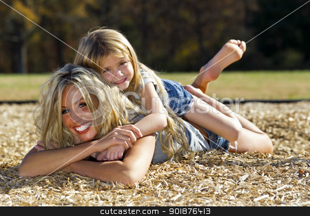 Mother Daughter stock photo, A mother and daughter enjoying a day at the park by Walter Arce