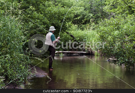 stream fishing stock photo, retired man fishing a small stream with a fly rod by digitalreflections