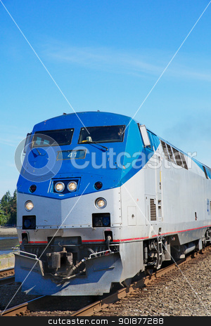 Train Engine stock photo, Blue and sliver lead train engine against a blue sky by bobkeenan