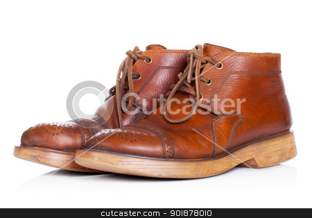 Red old leather boots isolated on white background stock photo, Red yellow old leather walking boots isolated on white background by Alexander Tarasov
