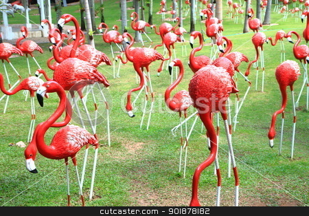 Red flamingos statue  stock photo, Red flamingos statue in park by kongsky