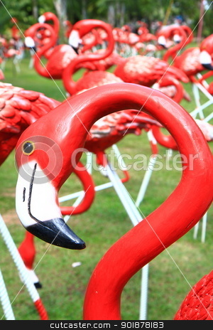 Red flamingos  stock photo, Red flamingos statue in park by kongsky