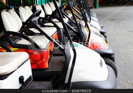 Golf carts  stock photo, Golf carts on a parking lot  by kongsky