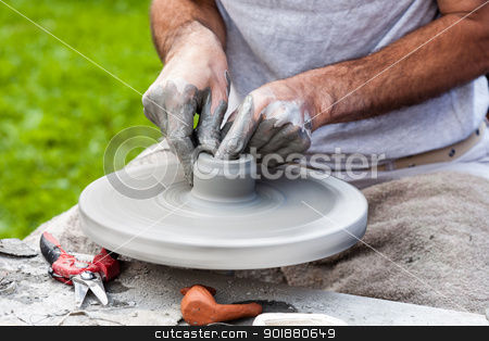 the pottery stock photo, potter's wheel helps to create unique pottery shapes by marekusz