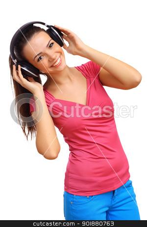 Happy smiling girl dancing stock photo, Happy smiling girl dancing and listening to music by Sergey Nivens
