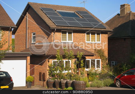 Solar panels on house stock photo, House roof with regenerative energy system - Solar panels by Fenton