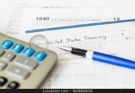 USA tax form 1040 for year 2012 with check stock photo, Tax form 1040 for tax year 2012 for US individual tax return with pen and check by Steven Heap