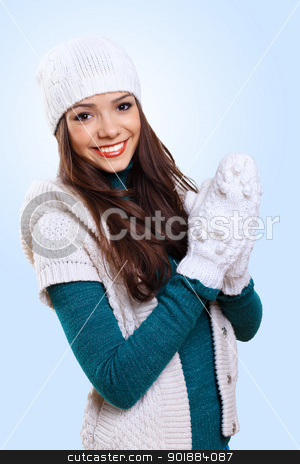 Young woman wearing warm sweater stock photo, Young pretty woman with lomng hair wearing warm pullover by Sergey Nivens
