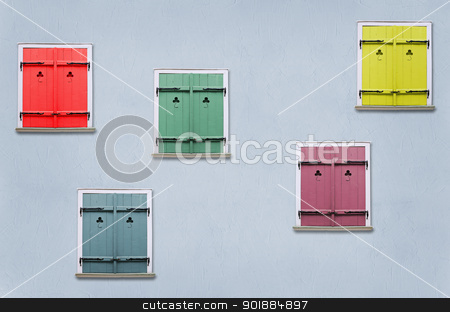 Shutters stock photo, closed windows with colorful shutters in the blue house wall  by Sergej Razvodovskij