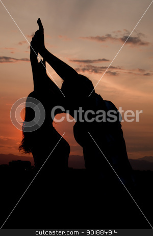 Silhouette stock photo, Couple kissing at sunset silhouette by Cora Reed